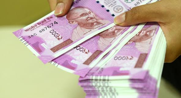 Indian Rupee opens lower at 71.29 per dollar